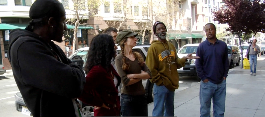 "discussing and brainstorming the future vision within the mural ""Windows Into The Tenderloin"""