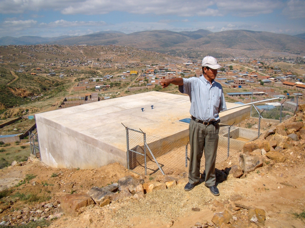 Don Félimón & the water tank his community built.