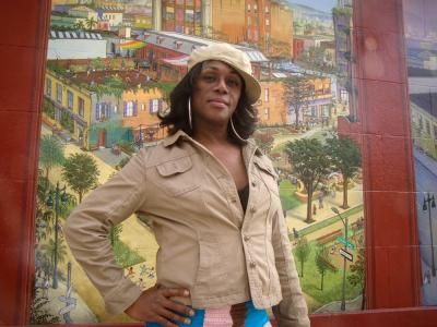 "Posing for ""Windows Into The Tenderloin"" - mural and photo by Mona Caron"
